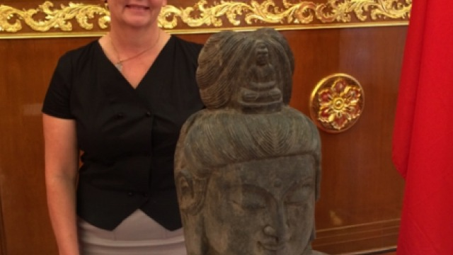 Dr Charlotte Galloway with the sculpture of Guanyin